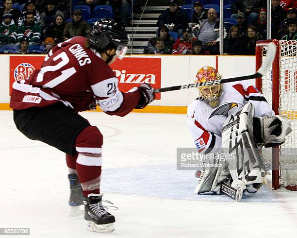 Lorenz Hirn of Team Austria stops the puck on a shot by Ronalds Cinks of Team Latvia during the 2010 IIHF World Junior Championship Tournament...