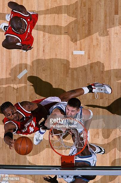Lorenzen Wright of the Atlanta Hawks puts a shot up over Brad Miller of the Charlotte Hornets during the game on April 12 2000 at Charlotte Colesium...
