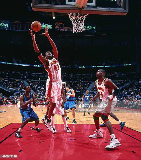 Lorenzen Wright of the Atlanta Hawks rebounds against the Minnesota Timberwolves on December 14 1999 at Philips Arena in Atlanta Georgia NOTE TO USER...