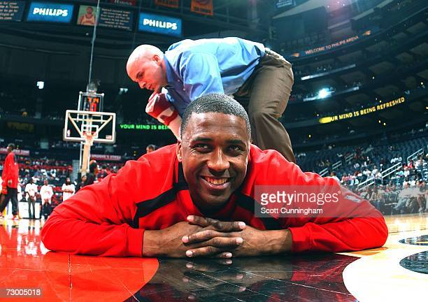 Lorenzen Wright of the Atlanta Hawks stretches with help from strength coach Chattin Hill before a game against the Boston Celtics at Philips Arena...