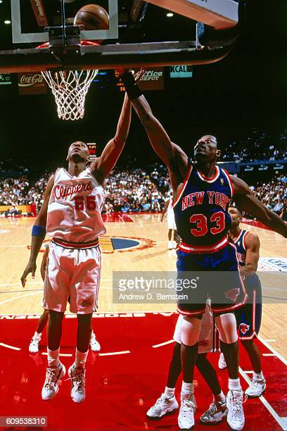 Lorenzen Wright of the Los Angeles Clippers defends against Patrick Ewing of the New York Knicks on November 8 1996 at the Los Angeles Memorial...