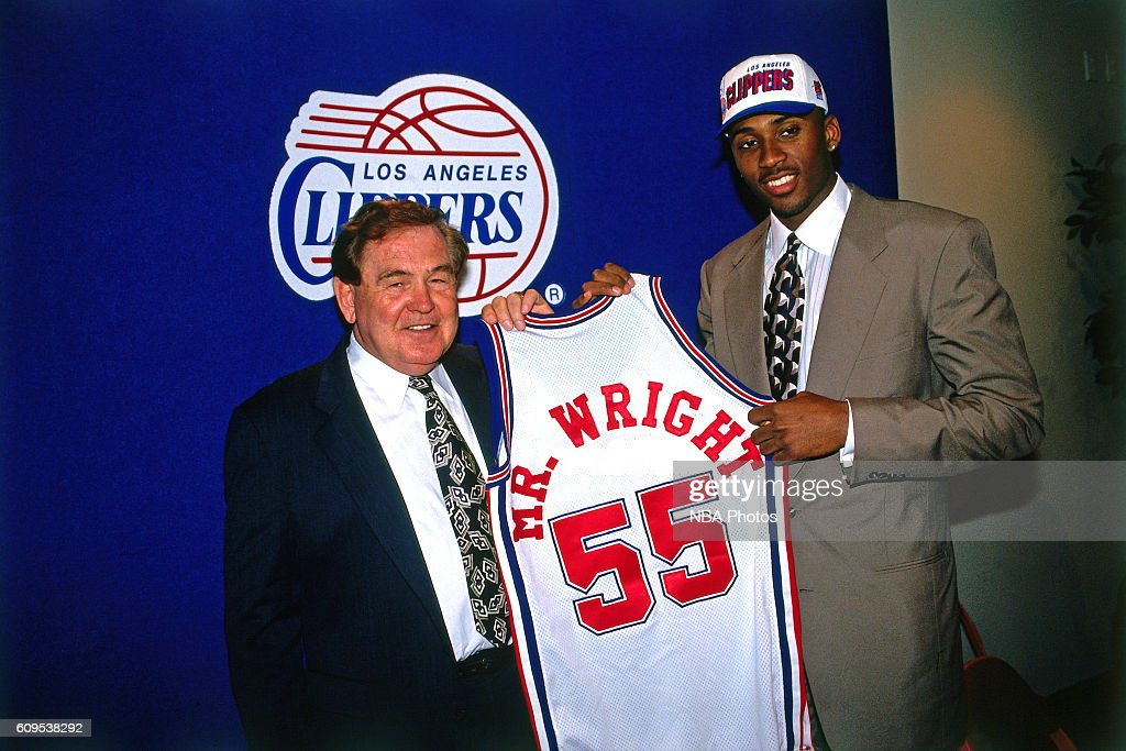 Lorenzen Wright #55 of the Los Angeles Clippers poses with Head Coach Bill Fitch in this circa 1996 photo at the Los Angeles Memorial Sports Arena in Los Angeles, California.
