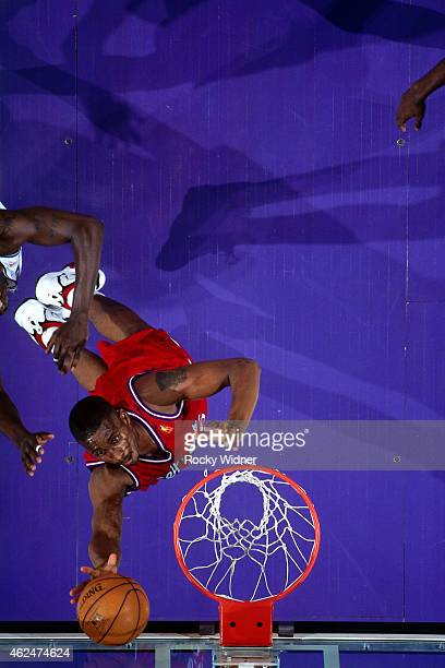 Lorenzen Wright of the Los Angeles Clippers rebounds against the Sacramento Kings during a game circa 1997 at Arco Arena in Sacramento California...
