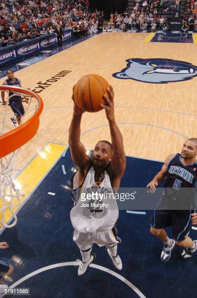 Lorenzen Wright of the Memphis Grizzlies goes up for a dunk during a game against the Utah Jazz at FedexForum on January 3 2005 in Memphis Tennessee...