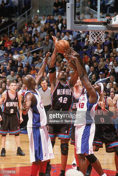 Lorenzen Wright of the Memphis Grizzlies goes up for the shot and is blocked by Elton Brand of the Los Angeles Clippers during the game at Staples...