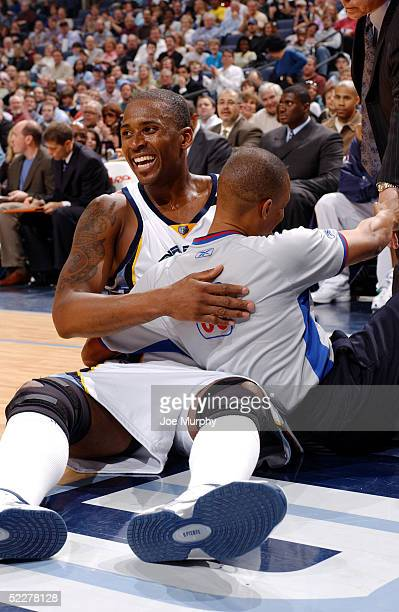 Lorenzen Wright of the Memphis Grizzlies laughs as he and referee Michael Smith get tangled up during a game against the Toronto Raptors on March 4...