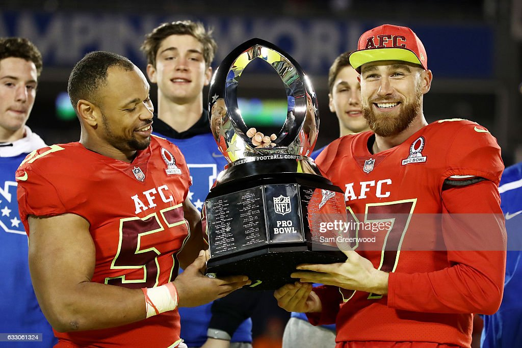 Lorenzo Alexander #57 and Travis Kelce #87 pose with the tophy after the AFC defeated the NFC 20 to 13 during the NFL Pro Bowl at the Orlando Citrus Bowl on January 29, 2017 in Orlando, Florida.