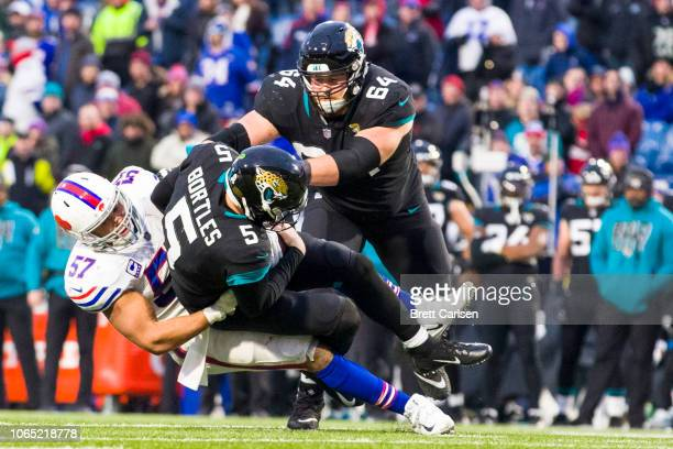 Lorenzo Alexander of the Buffalo Bills takes down Blake Bortles of the Jacksonville Jaguars during the fourth quarter at New Era Field on November 25...