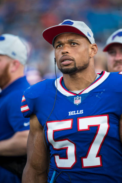 Lorenzo Alexander  57 of the Buffalo Bills walks on the sideline during the  game against 414243fa7