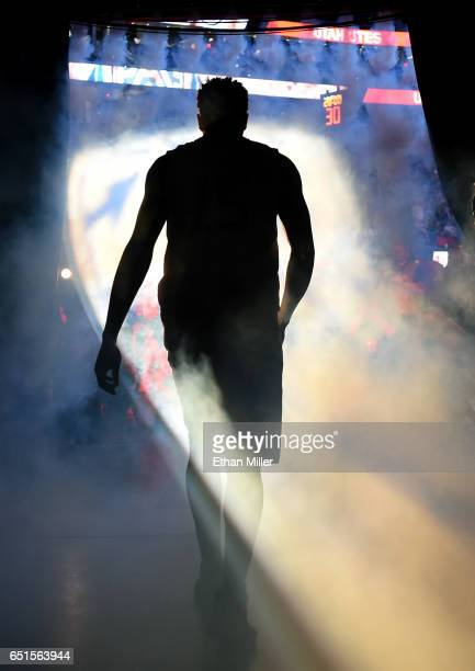 Lorenzo Bonam of the Utah Utes is introduced before a quarterfinal game of the Pac12 Basketball Tournament against the California Golden Bears at...