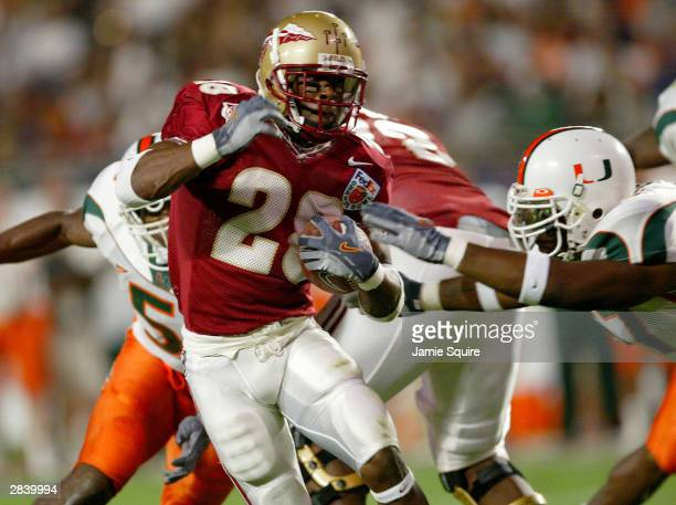Lorenzo Booker of the Florida State Seminoles carries the ball against the Miami Hurricanes during the Oranged Bowl January 1 2004 at Pro Player...