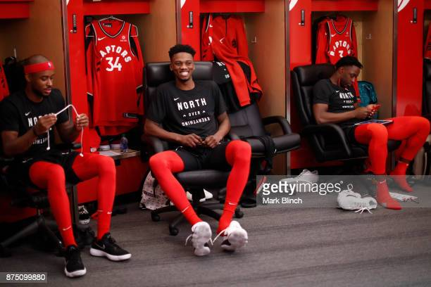 Lorenzo Brown Alfonzo McKinnie and OG Anunoby of the Toronto Raptors are seen in the locker room before the game against the Chicago Bulls on October...