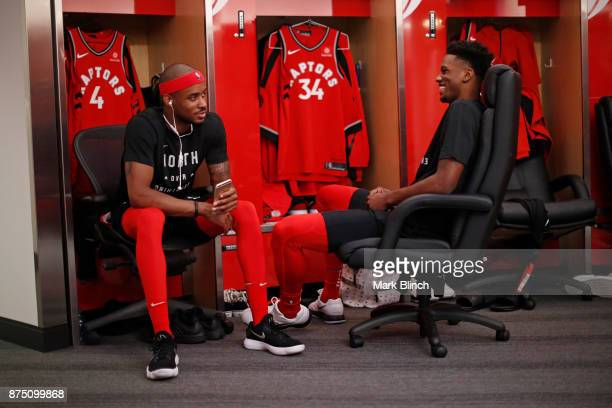 Lorenzo Brown and Alfonzo McKinnie of the Toronto Raptors are seen in the locker room before the game against the Chicago Bulls on October 19 2017 at...