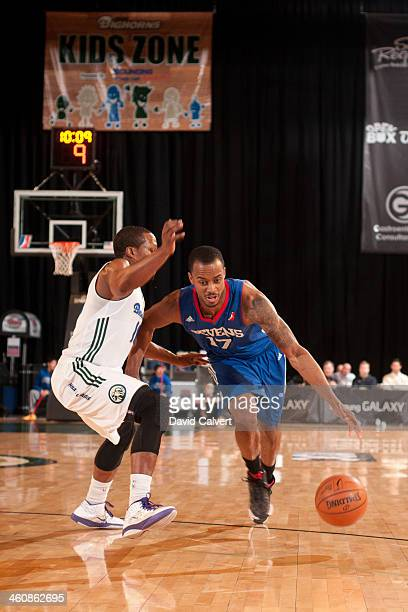 Lorenzo Brown of the Delaware 87ers drives against Tajuan Porter of the Reno Bighorns during the 2014 NBA DLeague Showcase presented by Samsung...