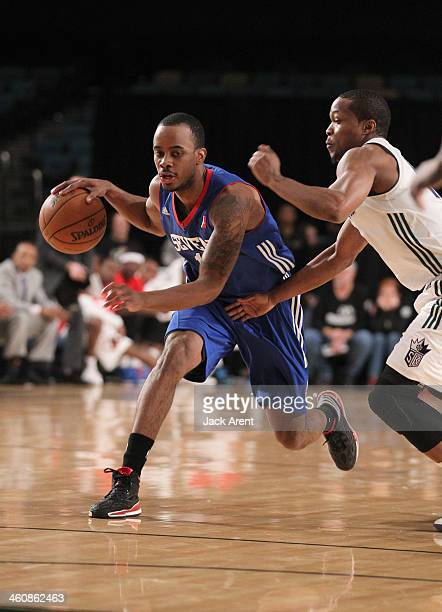 Lorenzo Brown of the Delaware 87ers drives against the Reno Bighorns during the 2014 NBA DLeague Showcase presented by Samsung Galaxy on January 5...