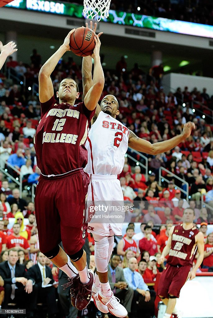 Lorenzo Brown #2 of the North Carolina State Wolfpack defends a shot by Ryan Anderson #12 of the Boston College Eagles during play at PNC Arena on February 27, 2013 in Raleigh, North Carolina. North Carolina State won 82-64.