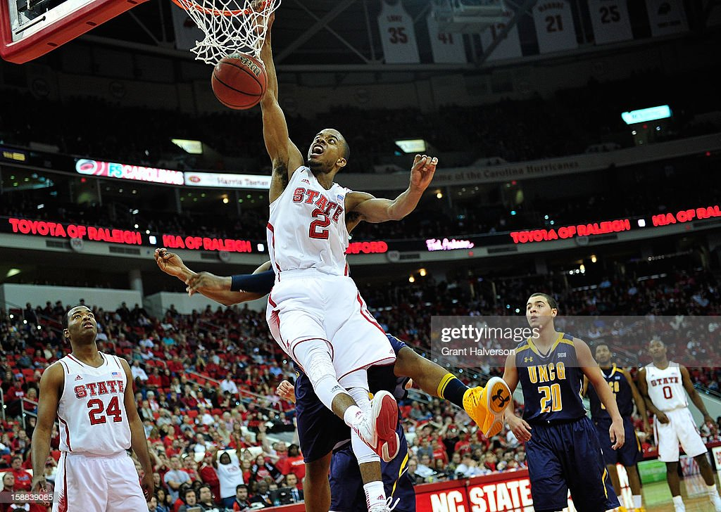 Lorenzo Brown #2 of the North Carolina State Wolfpack dunks a rebound against the UNC Greensboro Spartans during play at PNC Arena on December 31, 2012 in Raleigh, North Carolina. North Carolina State won 89-68.