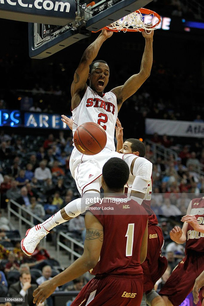 Lorenzo Brown #2 of the North Carolina State Wolfpack dunks in the first half against Gabe Moton #1 of the Boston College Eagles during their first round game of 2012 ACC Men's Basketball Conferene Tournament at Philips Arena on March 8, 2012 in Atlanta, Georgia.