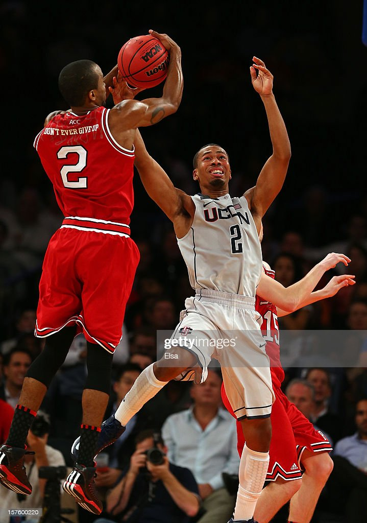 Lorenzo Brown #2 of the North Carolina State Wolfpack steals the ball from DeAndre Daniels #2 of the Connecticut Huskies during the Jimmy V Classic on December 4, 2012 at Madison Square Garden in New York City. The North Carolina State Wolfpack defeated the Connecticut Huskies 69-65.