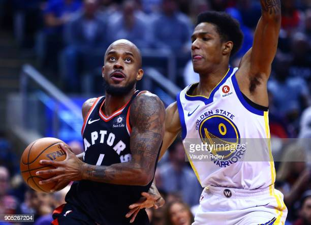 Lorenzo Brown of the Toronto Raptors dribbles the ball as Patrick McCaw of the Golden State Warriors defends during the first half of an NBA game at...