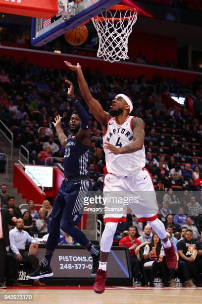 Lorenzo Brown of the Toronto Raptors gets to the basket next to James Ennis III of the Detroit Pistons during the second half at Little Caesars Arena...