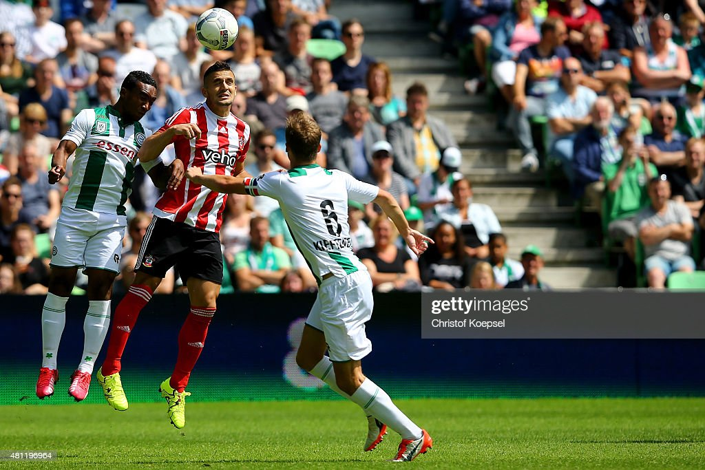 Lorenzo Burnet of Groningen and Dusan Tadic of FC Southampton go up for a header during the friendly match between FC Groningen and FC Southampton at Euroborg Arena on July 18, 2015 in Groningen, Netherlands.