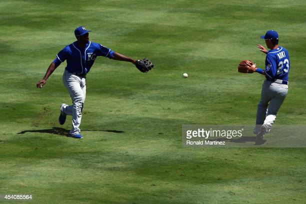 Lorenzo Cain and Norichika Aoki of the Kansas City Royals let a double fall inbetween them by Daniel Robertson of the Texas Rangers in the first...
