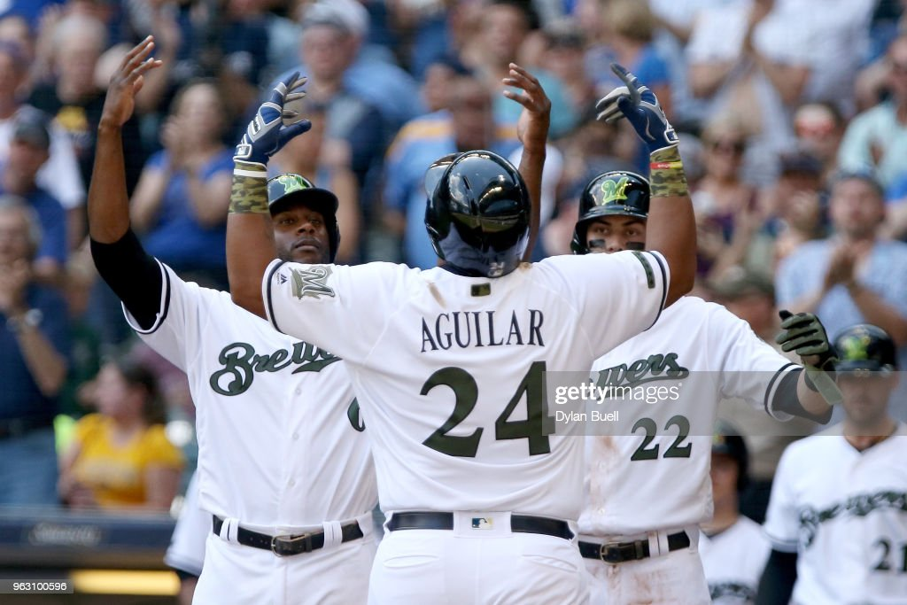 Lorenzo Cain #6, Jesus Aguilar #24, and Christian Yelich #22 of the Milwaukee Brewers celebrate after Aguilar hit a home run in the third inning against the New York Mets at Miller Park on May 27, 2018 in Milwaukee, Wisconsin.