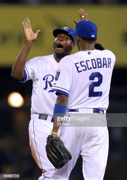 Lorenzo Cain of the Kansas City Royals and Alcides Escobar celebrate a 72 win over the Cleveland Indians at Kauffman Stadium on September 18 2013 in...