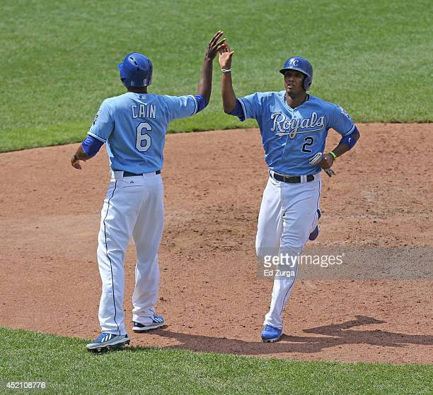 Lorenzo Cain of the Kansas City Royals and Alcides Escobar celebrate after scoring on an Omar Infante single in the seventh inning against the...