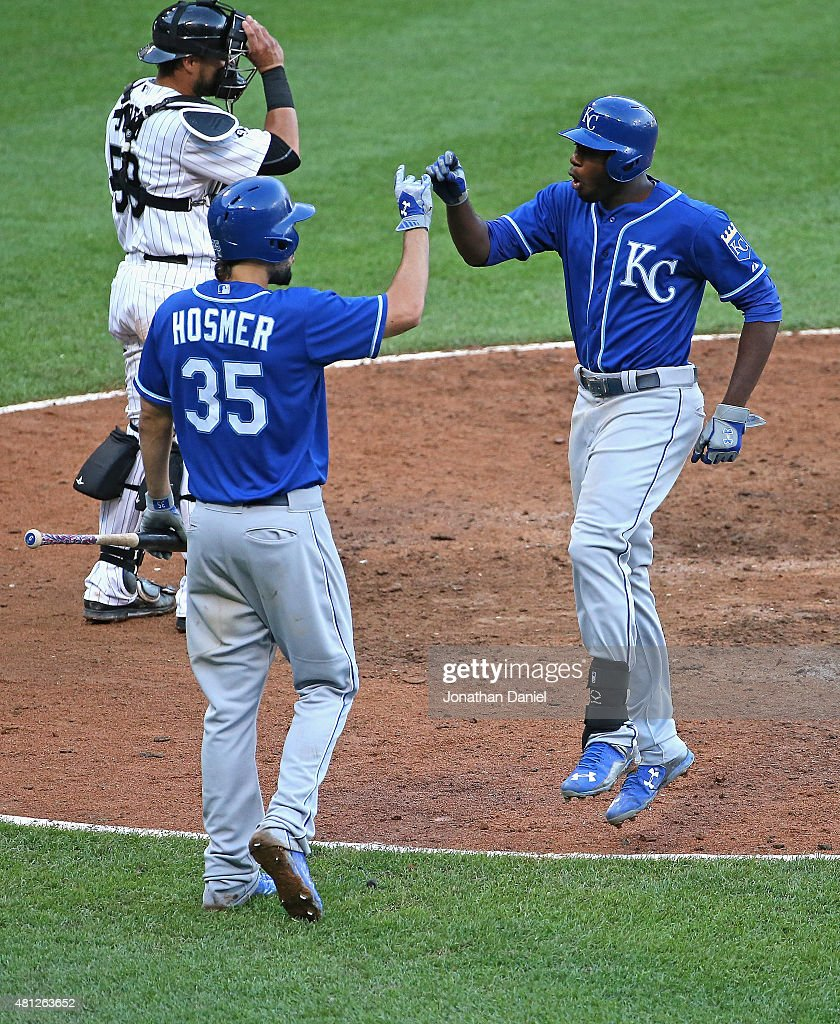 Lorenzo Cain #6 of the Kansas City Royals (R) celebrates his game-winning, solo home run in the 13th inning with Eric Hosmer #35 against the Chicago White Sox at U.S. Cellular Field on July 18, 2015 in Chicago, Illinois. The Royals defeated the White Sox 7-6 in 13 innings.