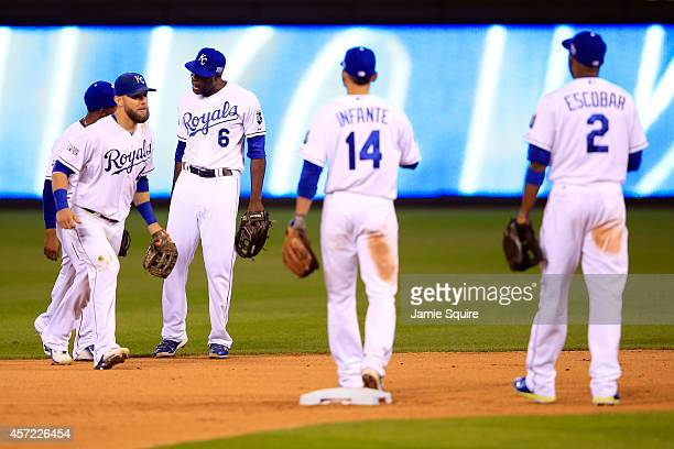 Lorenzo Cain of the Kansas City Royals celebrates with Jarrod Dyson and Alex Gordon after defeating the Baltimore Orioles 2 to 1 in Game Three of the...