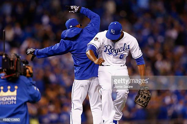 Lorenzo Cain of the Kansas City Royals celebrates with Jarrod Dyson of the Kansas City Royals after defeating the Toronto Blue Jays 50 in game one of...