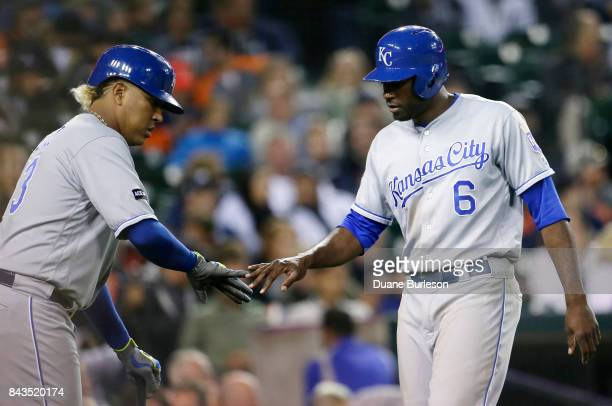 Lorenzo Cain of the Kansas City Royals celebrates with Salvador Perez of the Kansas City Royals after scoring on a wild pitch by Jairo Labourt of the...