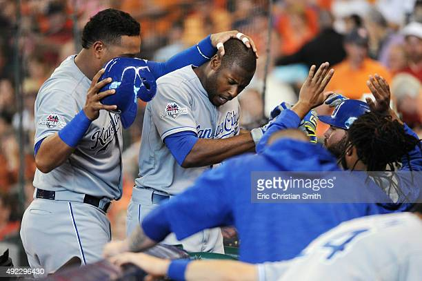 Lorenzo Cain of the Kansas City Royals celebrates with teammates after hitting a solo home run in the fourth inning against the Houston Astros in...