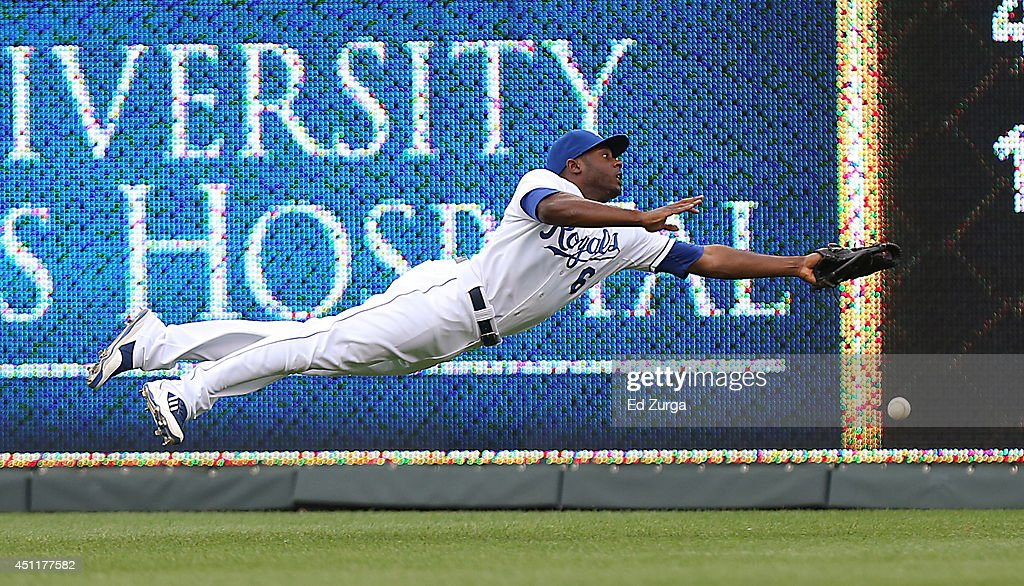 Lorenzo Cain #6 of the Kansas City Royals dives but can't catch a ball hit by Justin Turner of the Los Angeles Dodgers in the first inning at Kauffman Stadium on June 24, 2014 in Kansas City, Missouri. Turner picked up a triple on the hit.