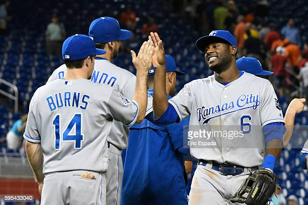 Lorenzo Cain of the Kansas City Royals high fives Billy Burns after beating the Miami Marlins at Marlins Park on August 25 2016 in Miami Florida