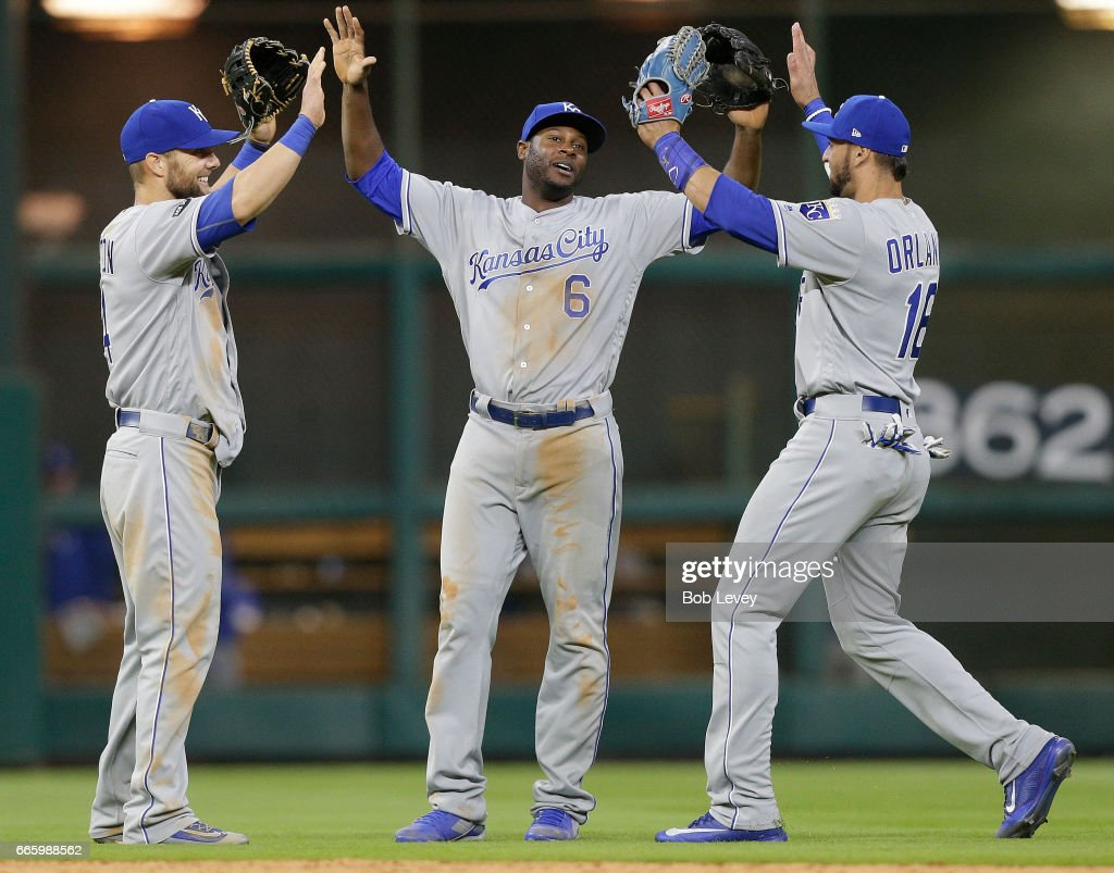 Lorenzo Cain #6 of the Kansas City Royals high fives Paulo Orlando #16 and Alex Gordon #4 after the final out against the Houston Astros at Minute Maid Park on April 7, 2017 in Houston, Texas.