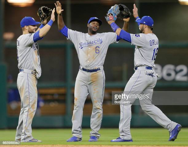 Lorenzo Cain of the Kansas City Royals high fives Paulo Orlando and Alex Gordon after the final out against the Houston Astros at Minute Maid Park on...