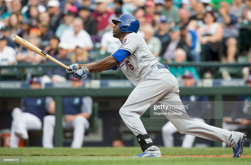 Lorenzo Cain #6 of the Kansas City Royals hits a sacrifice fly off of starting pitcher Andrew Moore #48 of the Seattle Mariners that scored Whit Merrifield #15 of the Kansas City Royals during the first inning of a game at Safeco Field on July 3, 2017 in Seattle, Washington.