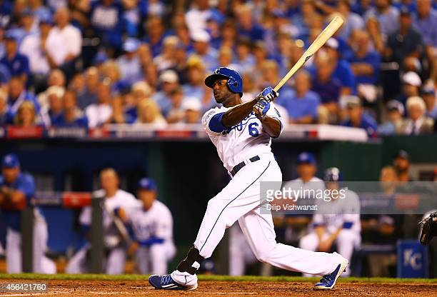 Lorenzo Cain of the Kansas City Royals hits an RBI double scoring Mike Moustakas in the third inning against Oakland Athletics during the American...