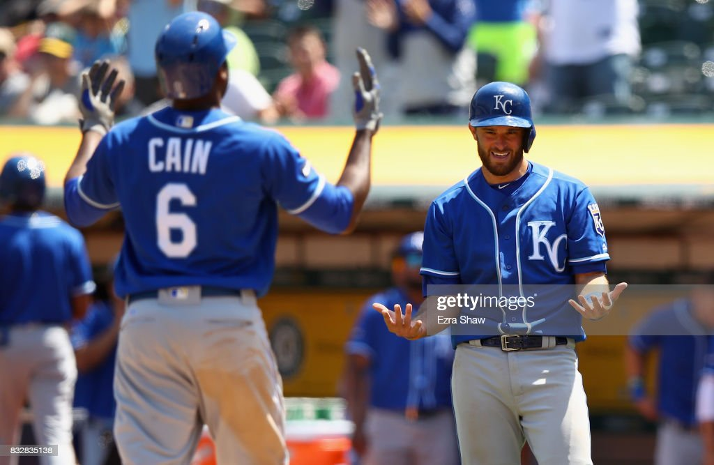 Lorenzo Cain #6 of the Kansas City Royals is congratulated by Drew Butera #9 after hitting a two-run home run in the fourth inning against the Oakland Athletics at Oakland Alameda Coliseum on August 16, 2017 in Oakland, California.