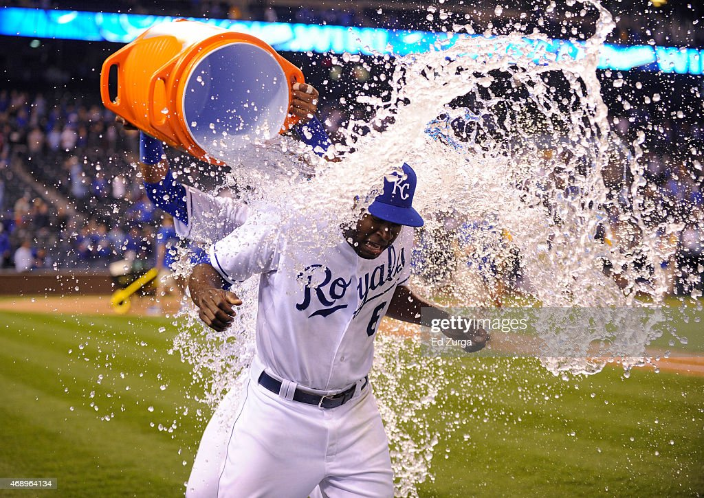 Lorenzo Cain #6 of the Kansas City Royals is doused with water by teammate Salvador Perez #13 as they celebrate a 7-5 win over the Chicago White Sox on April 8, 2015 at Kauffman Stadium in Kansas City, Missouri.