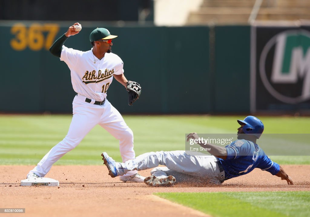 Lorenzo Cain #6 of the Kansas City Royals is forced out at second base as Marcus Semien #10 of the Oakland Athletics tries unsuccessfully to turn a double play on a ball hit by Eric Hosmer #35 in the first inning at Oakland Alameda Coliseum on August 16, 2017 in Oakland, California.