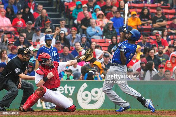 Lorenzo Cain of the Kansas City Royals is hit in the back by a pitch by Alexi Ogando of the Boston Red Sox during the seventh inning at Fenway Park...