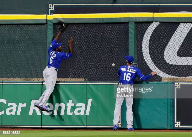 Lorenzo Cain of the Kansas City Royals leaps at the wall but able to make a catch on home run by George Springer of the Houston Astros in the first...
