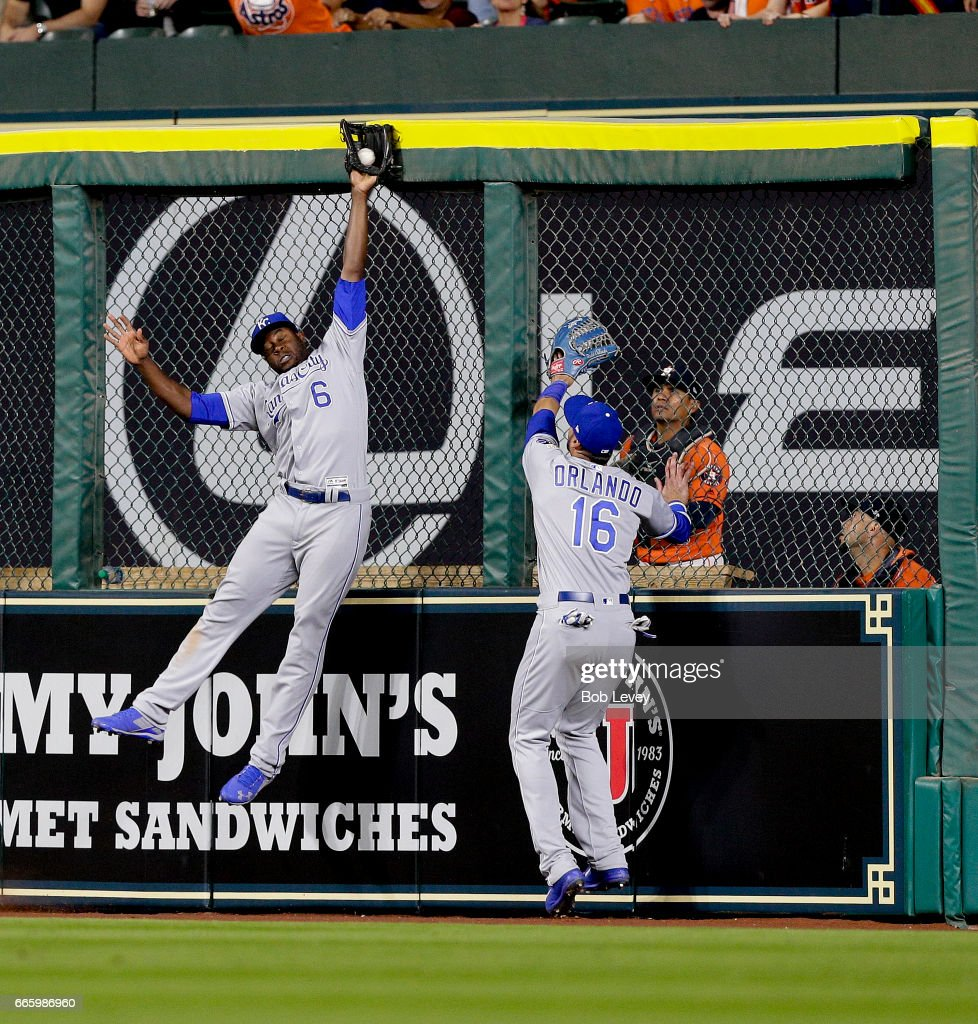 Lorenzo Cain #6 of the Kansas City Royals makes a leaping catch at the wall on fly ball by George Springer #4 of the Houston Astros in the eighth inning as Paulo Orlando #16 looks on at Minute Maid Park on April 7, 2017 in Houston, Texas.