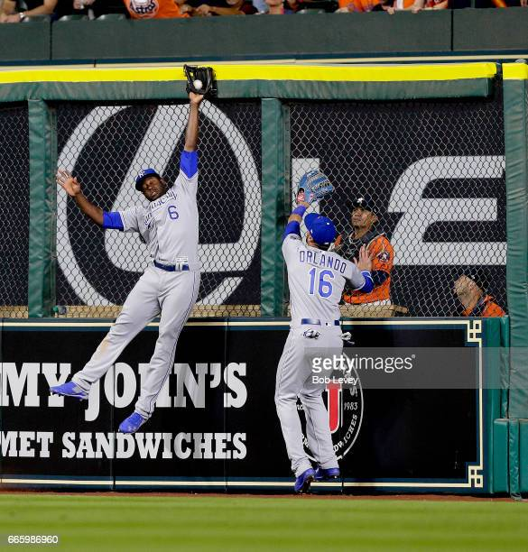 Lorenzo Cain of the Kansas City Royals makes a leaping catch at the wall on fly ball by George Springer of the Houston Astros in the eighth inning as...