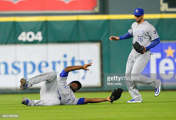 Lorenzo Cain of the Kansas City Royals makes a sliding catch as Paulo Orlando looks on in the fourth inning at Minute Maid Park on April 12 2016 in...