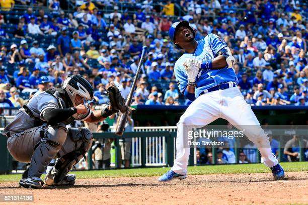 Lorenzo Cain of the Kansas City Royals reacts after being hit by the ball in the ninth inning against the Chicago White Sox at Kauffman Stadium on...
